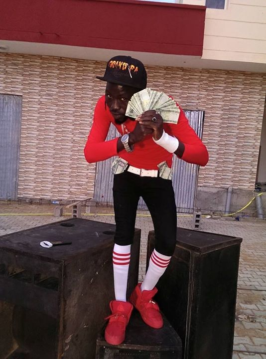 Silver X holding bundles of one pound notes during Dunia Karabu music video shoot