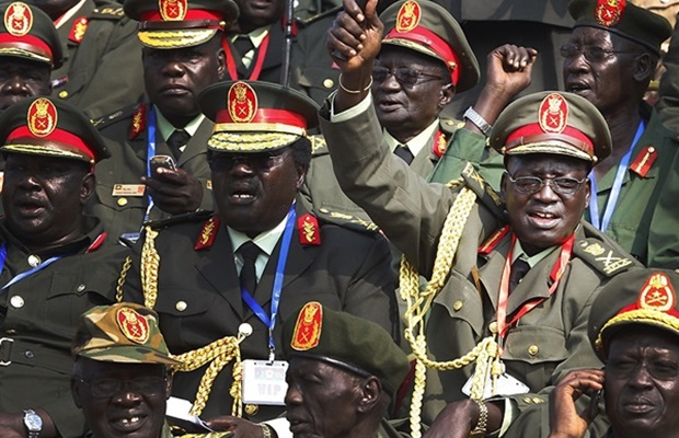 Generals of South Sudan's army celebrate during official independence day ceremonies. After two decades of civil war and two million deaths, their dream is finally realized.