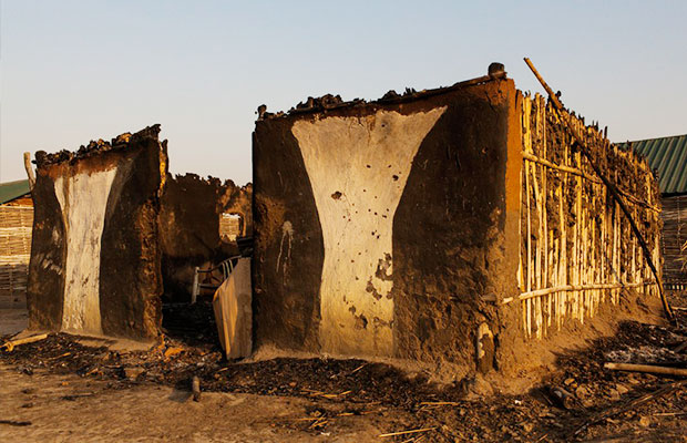 Unknown person burning houses to ashes in Torit