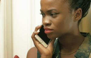 african girl on phone