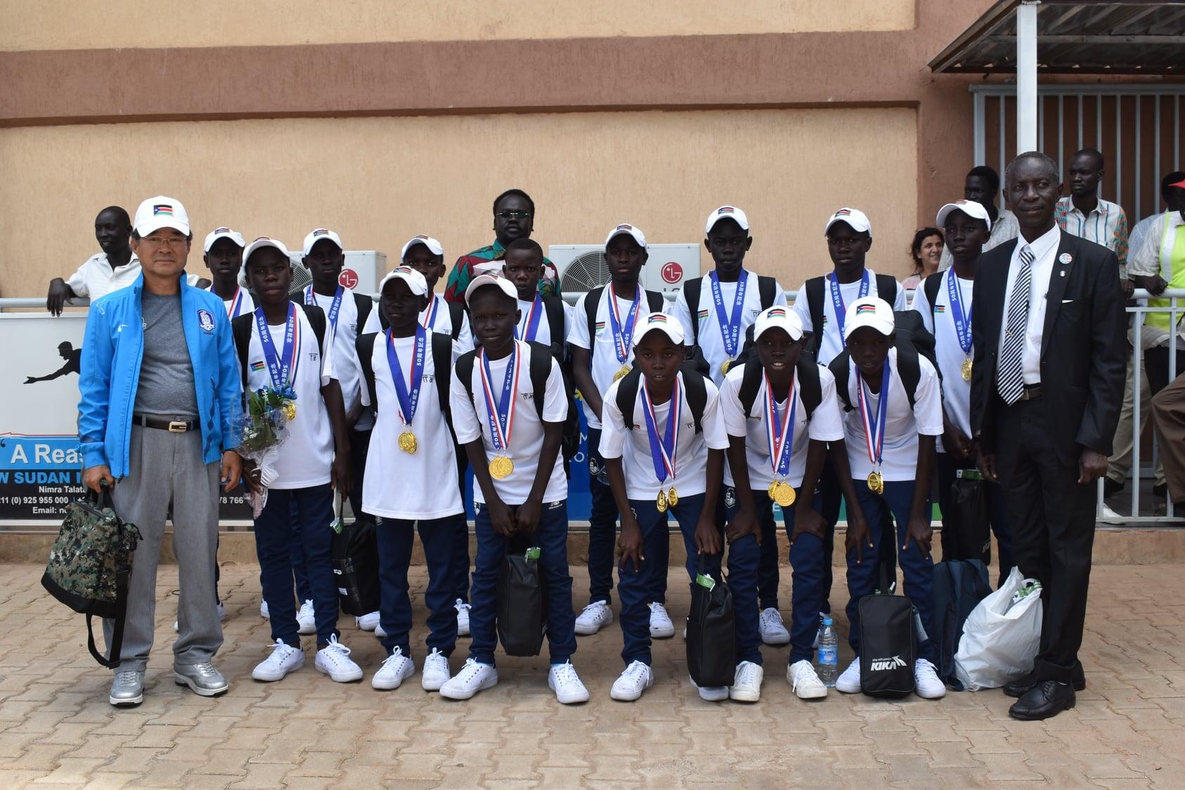 Victorious U12 team returns home