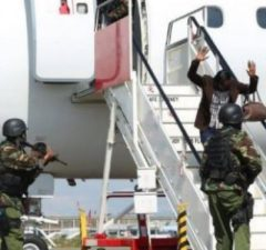 South Sudanese murder suspect being removed out of the plane at JKIA