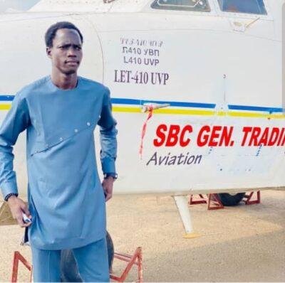 Bol Abuk poses for a photo with SBC Aviation aircraft