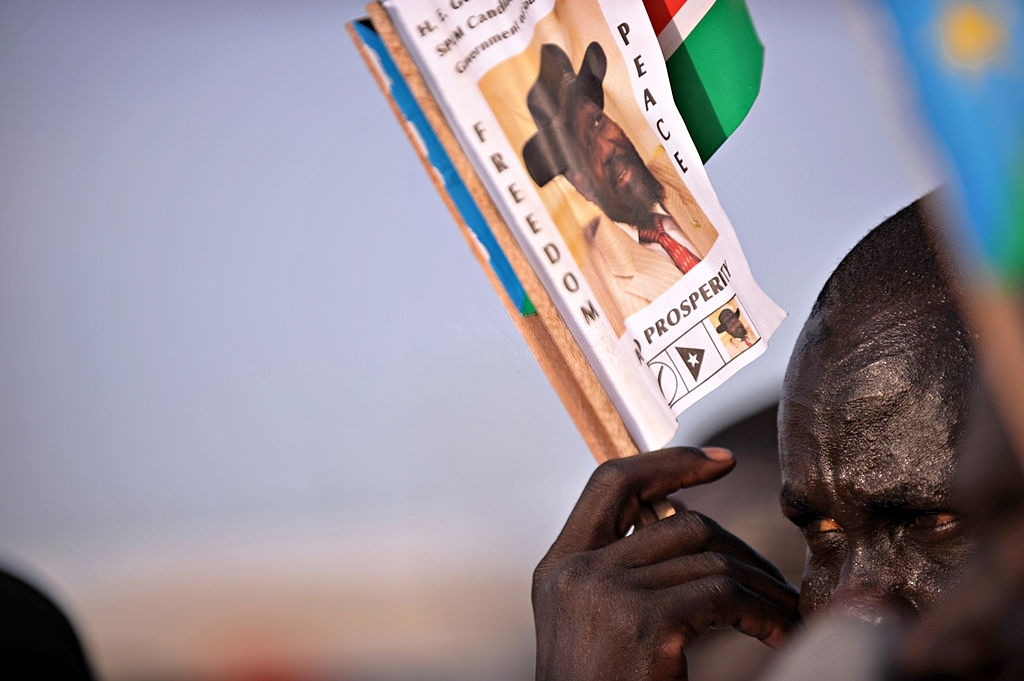 South Sudanese man holds a leaflet